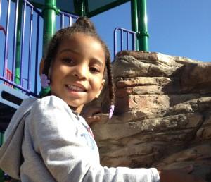 little girl climbing rock