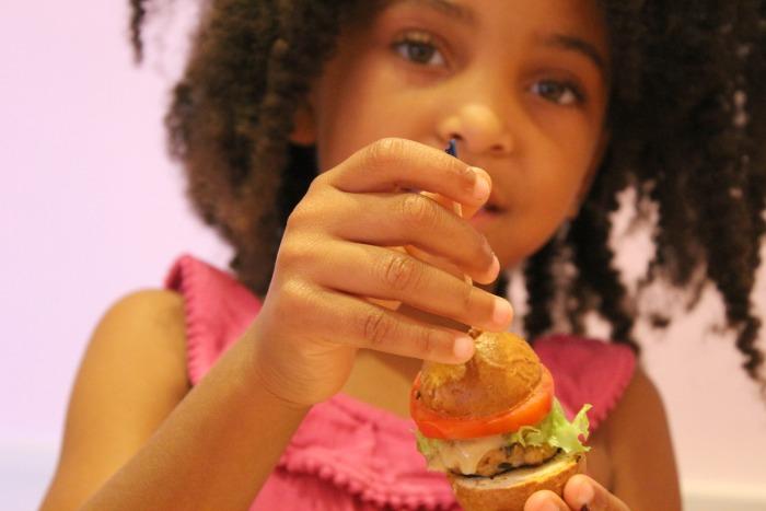 little girl with little burger at American Girl.jpg