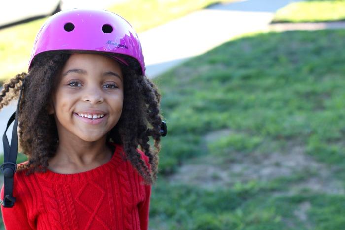 little girl in a helmet